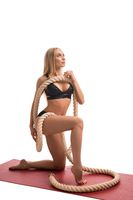 Fitness model with thick rope isolated view