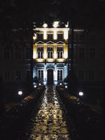 Exterior facade of classic building in the European city at night, architecture and design