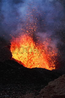 Night eruption volcano - lava lake, lava flowing in crater