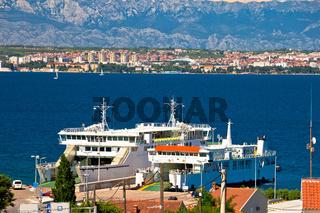 Island of Ugljan ferry port and Zadar view with Velebit mountain background
