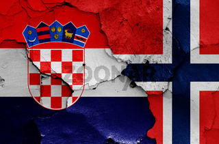flags of Croatia and Norway painted on cracked wall
