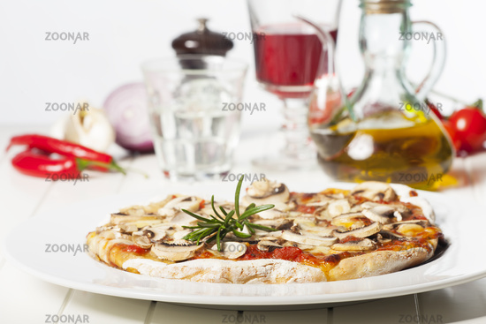 Italian Pizza Funghi on a white plate