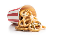 Crispy salted pretzels in paper cup