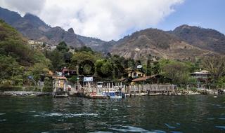 View from lake Atitlan to the coast of the mountain village Santa Cruz la Laguna, Guatemala