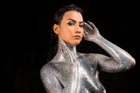 Pretty brunette with silver glitter bodyart