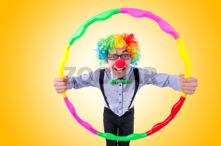 Funny clown with hula hoop on white