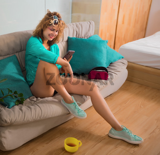 Woman sitting on a sofa. Self isolation concept