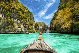 Traditional wooden boat in a picture perfect tropical bay on Koh Phi Phi Island, Thailand, Asia