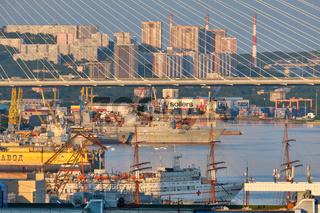 Vladivostok, Russia - Jul 01, 2020: Evening view of the bridge in the Golden swarm Bay. Sea city beach in summer.