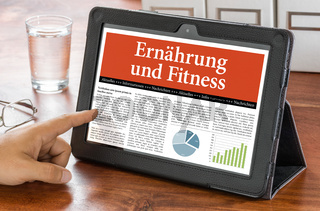 A tablet computer on a desk - Nutrition and Fitness - Ernaehrung und Fitness German