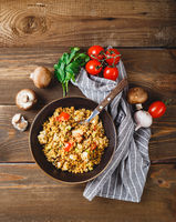 Couscous with turkey, tomatoes, champignon mushrooms and avocado.