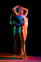 Nude couple in color lights shot