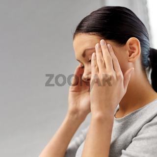 close up of unhappy woman having headache