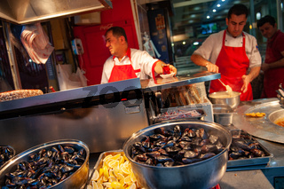 Famous Midye, Turkish stuffed mussels for sale in Balik Pasij on Istiklal street, Istanbul, Turkey,