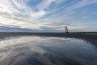 Wadden Sea with Lighthouse Obereversand in Dorum-Neufeld