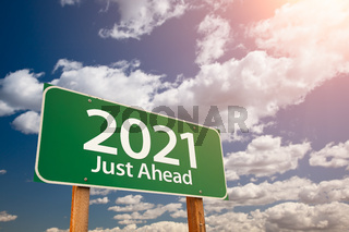 2021 Green Road Sign Over Dramatic Clouds and Sky