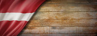 Latvian flag on vintage wood wall banner