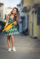 Portrait of a beautiful woman with skateboard