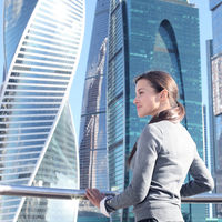 Businesswoman at skyscraper background