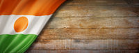Niger flag on vintage wood wall banner