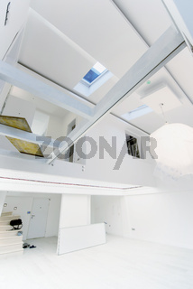 Interior of empty stylish modern open space two level apartment