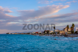 Windy Sunset and Promenade of a Small Greek Town