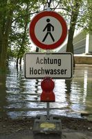Caution High Water, german sign with red warning