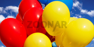 Multicolored balloons against the sky