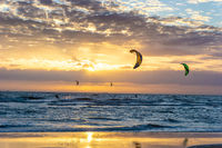 Kite surfing on the sea in sunset