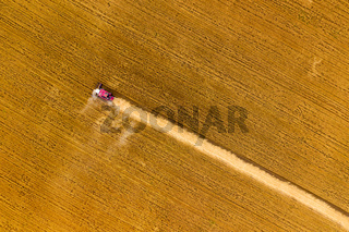 Top view of combine on harvest field