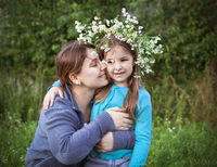 Pleased mother embracing daughter