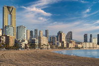 Benidorm skyline and sandy beach view.. Spain