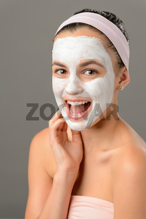Teenage beauty smiling girl white facial mask