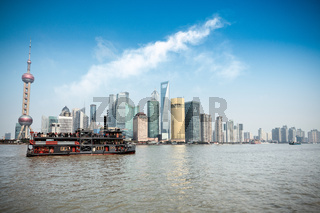 shanghai skyline and pleasure boat