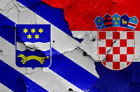 flags of Brod-Posavina County and Croatia painted on cracked wall