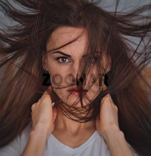 Woman portrait with fluttering long hair