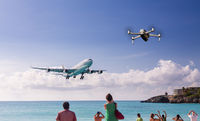 Concept of drone risking airplane landing at Princess Juliana airport