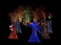 Outdoor christmas illumination of three angels