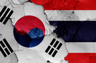 flags of South Korea and Thailand painted on cracked wall