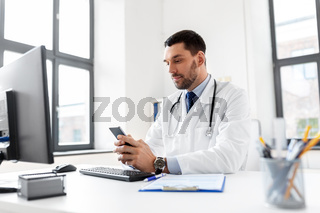 male doctor with smartphone at hospital