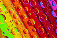 Color pencils under glass with drops of water.