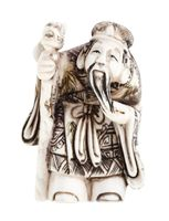 wise man with staff carved from ivory isolated