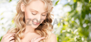 beautiful young woman face with long wavy hair
