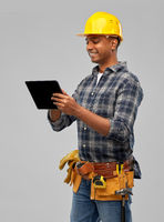 happy indian builder in helmet with tablet pc