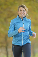 Woman jogging in autumn