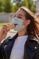 girl eats in mask