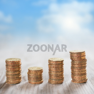 Stack coins with sky background