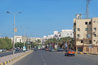 City panorama with street cars about buildings in Hurghada. Modern city with cars on highway