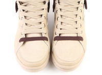 Top view of white sneakers.