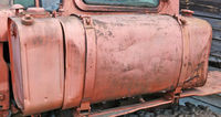 Old  red painted vintage metal steel  tank for diesel fuel from agricultural tractor